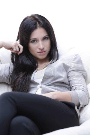 Foto de Cansado mujer sentada en un sillón cómodo y acogedor. foto con espacio de copia. - Imagen libre de derechos