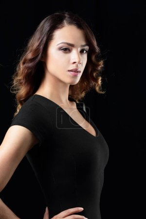 Beautiful and attractive model in black dress.