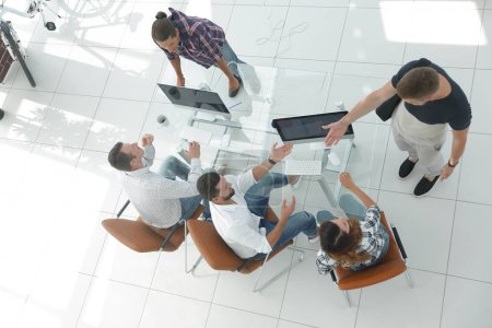Photo for View from the top. the creative team is working at your Desk in the office - Royalty Free Image