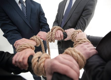 closeup.Hands holding rope forming a circle