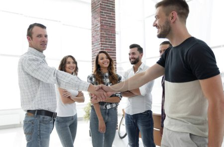 Handshake business people on the background of the...
