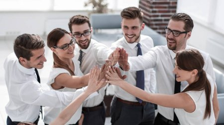 young business team giving each other high five