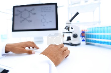 Photo for Research scientist using computer chemistry lab - Royalty Free Image