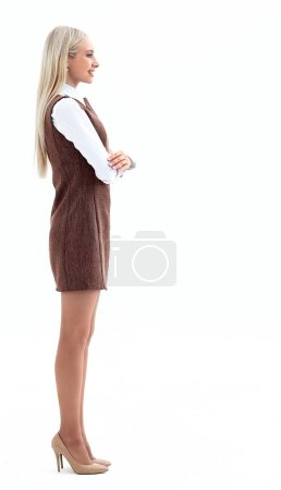 Photo for Portrait in full growth. smiling young woman assistant. side view. - Royalty Free Image