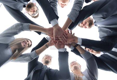 Photo pour Bas view.the équipe d'affaires fait une tour hors de main.the concept de travail d'équipe - image libre de droit