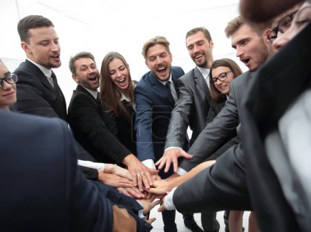 Photo for Concept of team building. large group of business people standing with folded hands together - Royalty Free Image