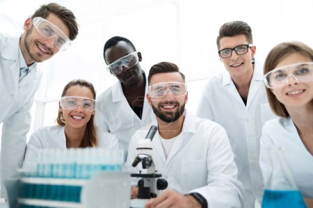 Photo for Group of Genetics engineering students working together in lab. Laboratory teamwork by college student indoors - Royalty Free Image