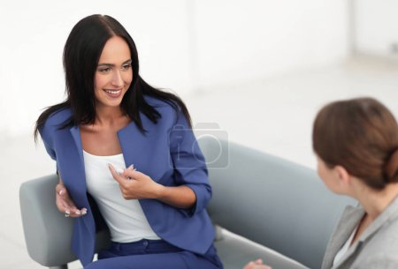 attractive business women meet in the office during a break