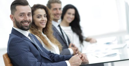 Photo for Closeup.group of business people sitting at the desktop - Royalty Free Image