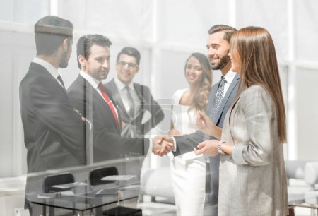 employees discuss business documents standing in the office