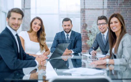 business Manager and employees at an office business meeting
