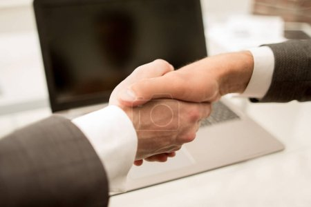 close up.background image of a handshake of business partners