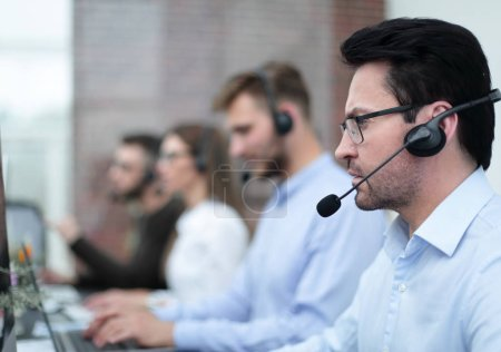 technical support specialist on the background of colleagues