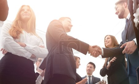 Photo for Welcome and handshake of business partners in the office.bottom view - Royalty Free Image