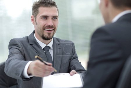 Photo for Closeup.smiling businessman signing a lucrative contract.the business concept. - Royalty Free Image