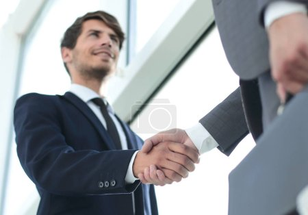 bottom view. handshake business partners in the office