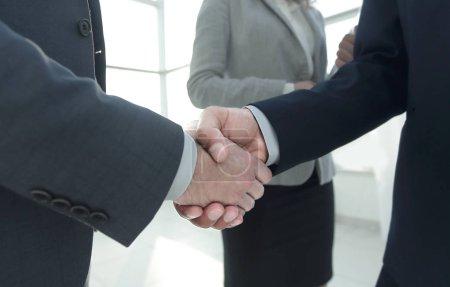 Close up business man handshake together on meeting room