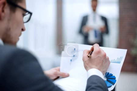 Photo for Close up.businessman checking financial data.business background - Royalty Free Image