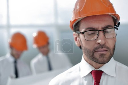 Photo for Close up.portrait of confident architect on blurred background .business people - Royalty Free Image