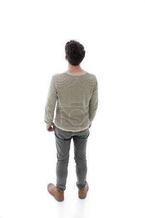 Photo pour Vue d'en haut. jeune homme moderne regarde avec confiance vers l'avant. Photo en pleine longueur - image libre de droit
