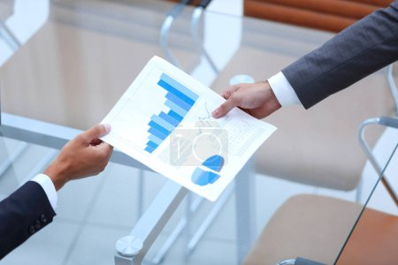 Photo for Business people discussing financial graphs showing the results of their successful teamwork - Royalty Free Image