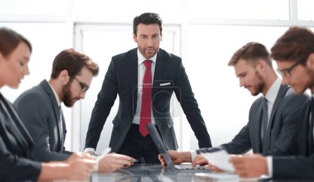 Photo for Strict businessman at a working meeting with the business team.office weekdays - Royalty Free Image