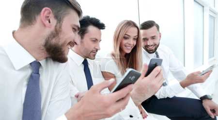 Close up.business team using their smartphones.peo...