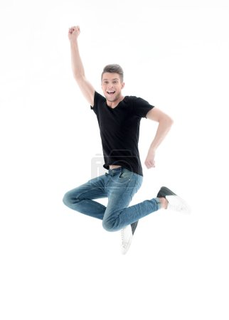 Photo for Happy excited cheerful young man jumping and celebrating success - Royalty Free Image