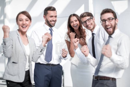 Photo for Happy business team celebrating their success.the concept of victory - Royalty Free Image