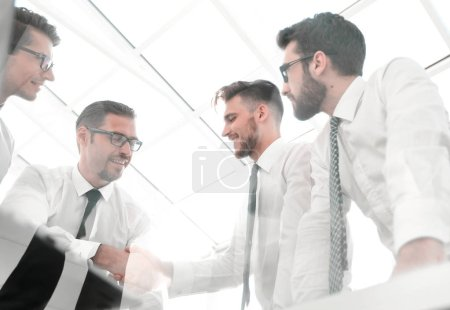 Photo for Bottom view.successful business team with a bright office. the concept of teamwork - Royalty Free Image