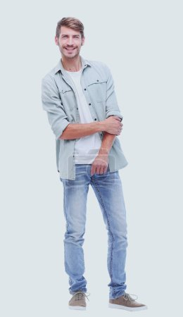Photo for In full growth.handsome modern guy in jeans.isolated on white background - Royalty Free Image