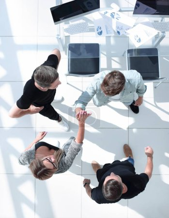 Photo for Top view of business people shaking hands after sealing a deal. High angle view - Royalty Free Image