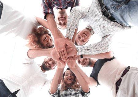 Photo pour Vue du bas. équipe d'affaires avec les mains jointes together.team building - image libre de droit