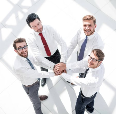 Photo for Top view. business team putting their hands together.the concept of teamwork - Royalty Free Image