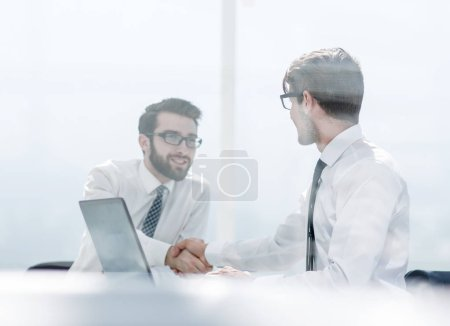 Photo for Two employees shaking hands at the Desk.photo with copy space - Royalty Free Image
