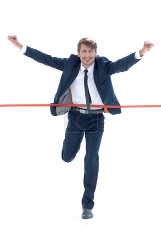 Photo pour Homme d'affaires courant vers la ligne d'arrivée en premier avec plaisir. Concept de compétition dans la course, la gestion d'une entreprise - image libre de droit