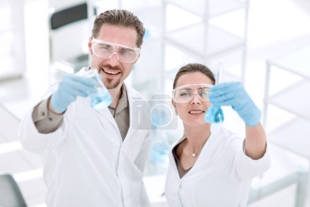 Photo for Scientist and assistant with tubes, standing in the laboratory.photo with copy space - Royalty Free Image
