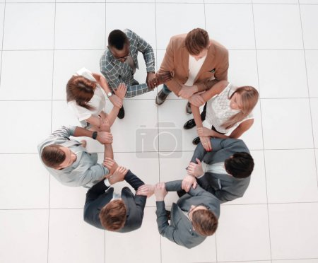 top view.the business team holds each others hands