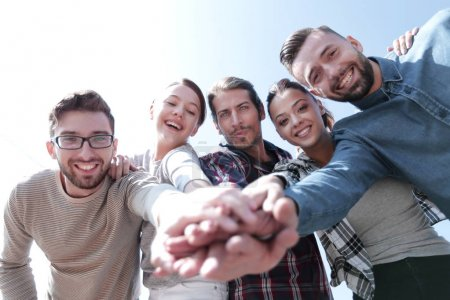 Photo for Active young people ,with hands clasped together.photo with copy space - Royalty Free Image