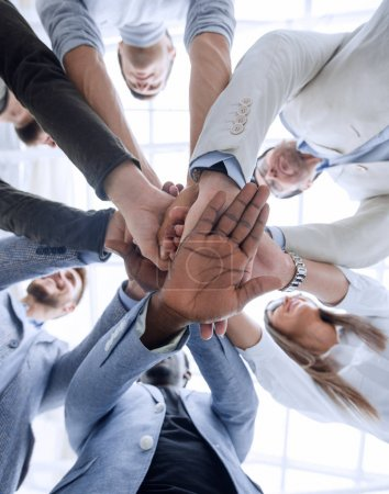business background.business team making a stack of hands