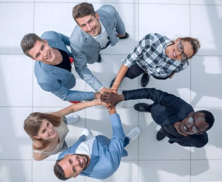 Photo for Its a dream team Top high angle view Full length body, size and high angle view portrait of carefree, trandy hipster folded hands stacked on top of each other in the end of a successful teamwork - Royalty Free Image