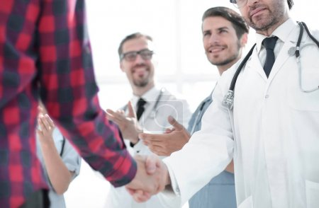 doctor talking with a guy, shaking hands