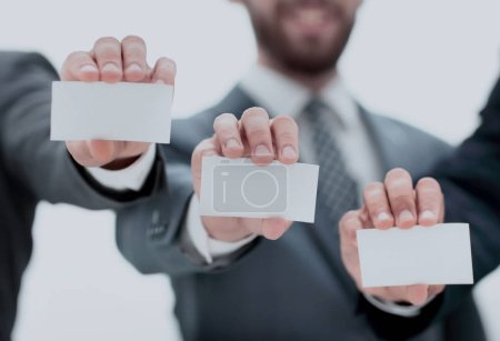 Photo for Business people showing their business cards.business concept - Royalty Free Image