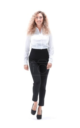 In full growth. a young business woman striding co...