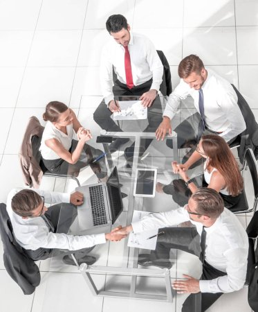 Photo for Office workers gather around a table to do research and implement new ideas. - Royalty Free Image