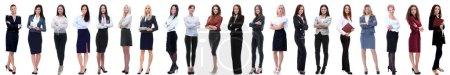 Photo pour Groupe de succès jeune femme d'affaires debout dans une rangée. isolé sur fond blanc - image libre de droit