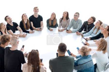 study group of young people sitting at a round table