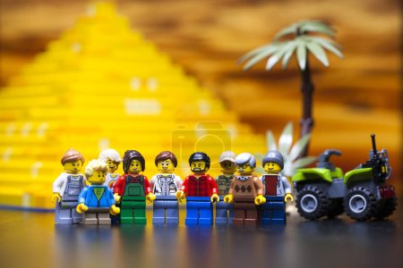 RUSSIA, April 12, 2018. Constructor Lego Classic - Minifigurki little people. Group of tourists near the Egyptian pyramid