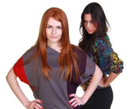 Portrait of two girlfriends - brunette and red-haired model, isolated on white background