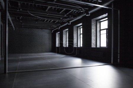 Empty room of black brick